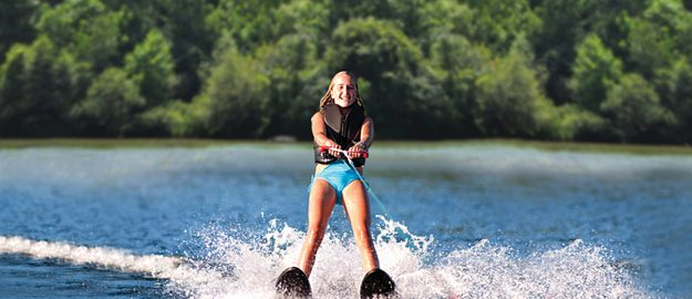 Water skiing on private lake